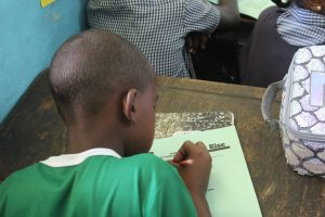 Student fills in Pre-Test at Port Maria Primary.